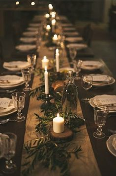 """Table Runner With Greens + Candles By Design My Night"""" show_pin_button:""""true"""" --> Are you hosting a special dinner this winter season? My favorite way to dress up a table is with some simple greens and plenty of candles. You can use clippings from your yard and your holiday tree; you can even use herbs from your kitchen if you have an over abundance. Here are five lovely arrangements to get you inspired."""