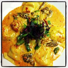 Smoked Chicken Ravioli with Asparagus, Mushrooms and Shallots with Sun-Dried Tomato Cream