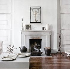 Bank Street by Huniford Design Studio, fireplace in an all white room with carefully displayed art on either side and wooden floors. The white art helps it blend in so the overall result is minimalistic. How to display art. Gentlemans Quarters, Barn House Design, Living Room New York, New York Apartments, Transitional Living Rooms, Inspired Homes, Modern Interior Design, Interior Styling, Elle Decor