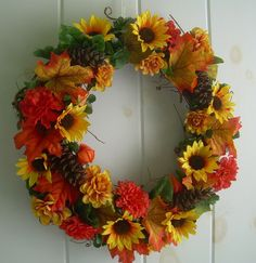 fall wreath, autumn wreath with sunflowers, mums, orange chinese lanterns and pine cones,grapevine wreath