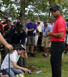 Tiger Woods reaction after hitting a spectator with a golf ball.  Moral of the story, don't piss off Tiger. #fore
