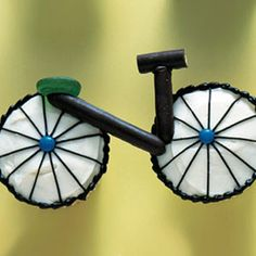 Bicycle Cupcakes made with M&M's and Gumdrops. The handlebars and axle could be created with black licorice