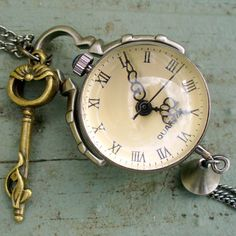 Steampunk pocket watch Necklace key pirate Victorian locket pendant charm Tiny Steam ORB with little WITCHY KEY pocket watch  Necklace. $19.99, via Etsy.