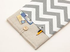 11 inch Macbook AIR case. Linen macbook case with chevron pocket and button closure.Macbook case padded. Custom orders available. $23.90, via Etsy.