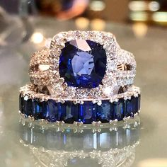 Round sapphire and diamond ring in split shank setting paired with an emerald cut sapphire wedding band.  www.alsonjewelers.com