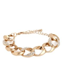 This one's a classic—with a glittering twist. The bracelet features gorgeous curb links, cast in soft sun-kissed gold, with a sprinkling of pavé crystals to up the glamorous ante.
