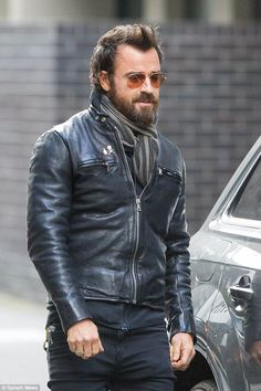 Facial hair: He sported a bushy beard flecked with strands of grey and completed his look with aviator-style sunglasses, a striped scarf and black suede shoes