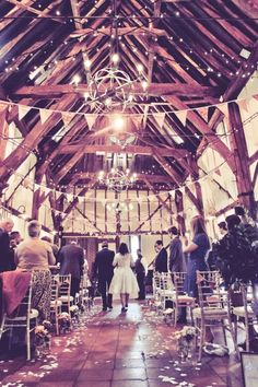 Lovely canopy of lights, nice touch using a double strand of lights in the cross design! Rustic DIY Bedfordshire Wedding http://www.shearsmockford.com/