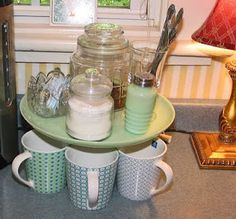 Cake stand turned coffee station - I am going to make this a tea station with my Grandma's cake stand. Will be cool on kitchen table!