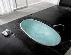 So as I was gazing longingly at this bathtub design called 'Sorgente' by Lenci Design for Teuco, I realized that I was schooled on the difference