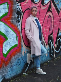 pastel pink coat and pastel pink hair