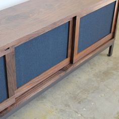 farmhouse modern credenza with custom speaker fabric doors by chadhausdesign