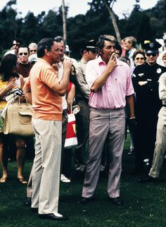 Frank Sinatra & Dean Martin have a smoke while playing golf, 1972.