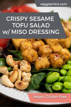 This Crispy Sesame Tofu Salad with Miso Dressing is as fresh as you can get. It's packed with raw veggies, baked crispy sesame tofu, and roasted cashews- all with loads of Asian flair. #vegansalad