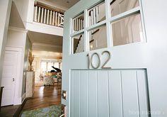 1) Front door color: Benjamin Moore's Wythe Blue (HC-143) 2) Trim color (indoor and out) is Benjamin Moore's White Dove (OC-17) 3) Entry color: Restoration Hardware's Silver Sage 4) Address numbers on the door: Home Depot  Closet Door Front Door
