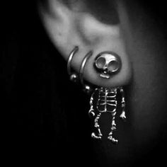 jewels skull earrings silver cool skeleton earphones jewelry bones funny skeleton earring scull earings cute scary gold hipster ear idk love more skull body jewelry piercing halloween accessory skull earrings grunge grunge jewelry Piercings Bonitos, Body Piercings, Piercing Tattoo, Ear Piercings Gauges, Lower Lip Piercing, Lobe Piercing, Soft Grunge, Halloween Accessoires, Different Ear Piercings