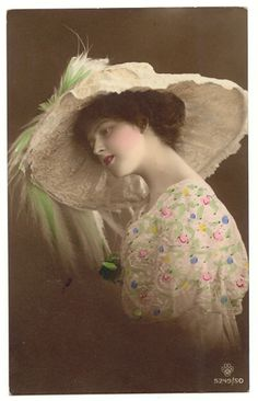photo lady in flowered dress with large hat and green feather