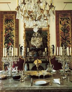 Jacques Grange found the 18th-century mirror in the dining room. A Louis XV chandelier lights the space, which includes Gobelins tapestry panels. On the marble-topped Ruhlmann table is a silver-gilt ewer and basin that once belonged to an archduke of Austria.