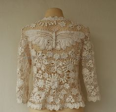 """translation of text from http://www.ivelisefeitoamao.com.br:  """"This is the """"Cardigan Kazan"""", which was made using the technique of modern Irish crochet, and lace of Bruges."""""""