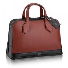 Louis Vuitton Dora MM Bag, $4,650