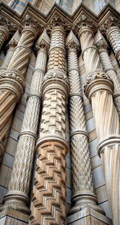 Romanesque - The Natural History Museum of London. It was built from by Alfred Waterhouse after the original designer Francis Fowke died. As can be seen from these columns, Waterhouse added his own Romanesque touches.