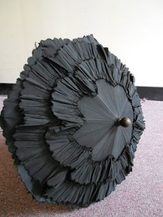 1860's-70's, printed white box, and jointed black parasol with carved wooden handle