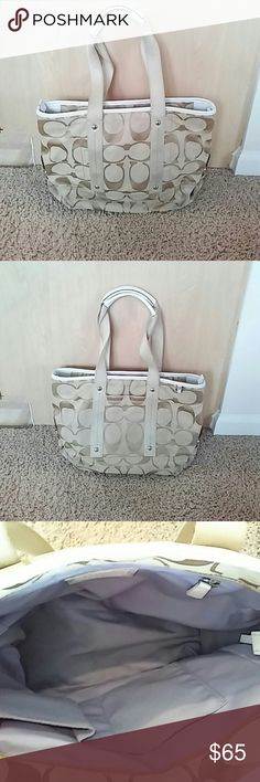 Coach Beige Handbag Medium sized coach handbag with white leather straps. Pocket on front with a main zipper closing pocket with three small ones inside. Inside has some minor stains but overall in good shape. Outside has some minor stains but no holes or rips. Still tons of life left Coach Bags Shoulder Bags