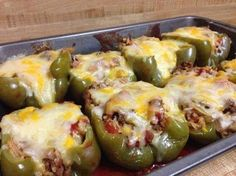 INGREDIENTS:   6 medium green peppers 1 lb ground beef 1 chopped onion 1 (6 7/8 ounce) box of Rice-a-Roni mix, Spanish flavou...