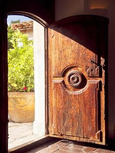 heavy carved door in the sun