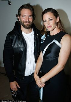 Reunited: Sporting a leather jacket and a burly beard, Cooper flashed a grin as he caught up with Garner at the fashionable function in France