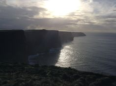 Cliffs of Moher looking back into late afternoon sun.