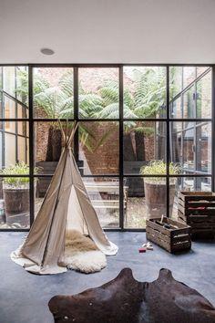 New Orleans modern - brickwork, steel mullions, atrium and palm trees. ANNA+NINA Department Store,  Amsterdam