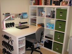 Ikea expedit desk/shelf workstation. I like the bars used for punches. You can see them easily.