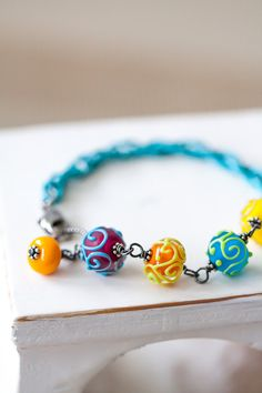 ~ OOAK - One of a kind bracelet ~ Fascinating colorful Lampwork beads in purple/blue, orange/yellow, blue/green and yellow/pink, handmade by US