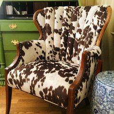 We are utterly smitten with how this cow print fabric turned out on this antique, channel-back chair! Old chair upstairs redo project Cowhide Decor, Cowhide Furniture, Cowhide Chair, Reupholster Furniture, Western Furniture, Chair Upholstery, Upholstered Chairs, Rustic Furniture, Cool Furniture