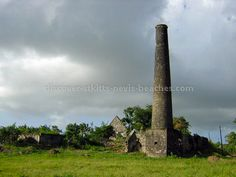 "Saint Kitts - La Valle Sugar Estate Ruins in the Sandy Point Area - ""... An inventory of Heritage Sites & complexes included in the 1993 OAS Tourism Master Plan for St Kitts & Nevis documents about 250 such sites. A # of which have been developed as heritage & cultural attractions, but many of which are relatively unexploited/undeveloped ... remains of the plantation great houses, sugar mills & chimneys, forts, & the colonial style architecture of the buildings in Basseterre & Charlestown."""