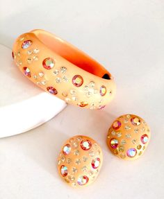 Soft Coral or Peach Thermoset and Rhinestone Demi, Hinged Bangle and Earring Set, Unsigned Weiss, Coral Aurora Borealis Rhinestones, by Vintageimagine on Etsy https://www.etsy.com/listing/276451830/soft-coral-or-peach-thermoset-and
