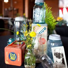 Love the jars and flowers, would prob use antique books or other things instead of cracker tins