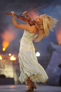 Mairead Nesbitt fiddler in Celtic Woman ~love this music!!  I would love to learn how to play really well.