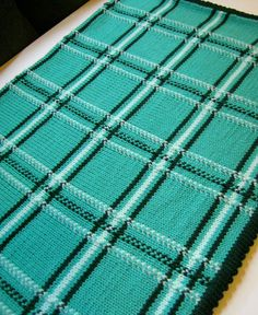 Free Knitting Pattern for Plaid Baby Blanket - Baby blanket with colorwork plaid design byYana Ivey.The final size of the blanket is about 3 x 3 feet. Pictured project byjenzilla9