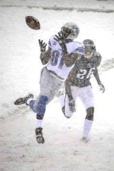 Detroit Lions' Calvin Johnson (81) catches a pass as Philadelphia Eagles' Cary Williams (26) defends during the first half of an NFL footbal...