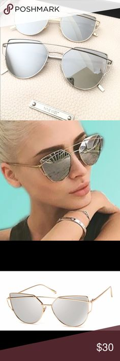 Trendy sunglass Trendy sunglass in gold trim .Thick sturdy frame , reflective glass. NO TRADE Accessories Glasses
