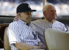 New York Yankees Hall of Famers Yogi Berra, left, and Whitey Ford sit in the shade of a golf cart as they are introduced before the Yankees Old Timers Day baseball game, Sunday, June 23, 2013, at Yankee Stadium in New York.