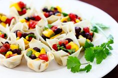Love this idea for a healthy appetizer: black bean and mango salsa cups