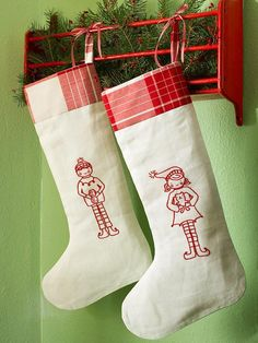 Stitched Elf Stockings....i know my friend Jen could totally rock these <3