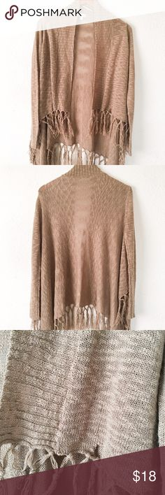 Charming Charlie Fringed Cardigan Beautiful piece, unfortunately has a hole on the right opening flap! Very soft and lightweight! A more accurate color is pictured in the last photo. Charming Charlie Sweaters Cardigans