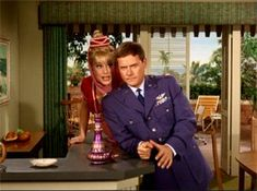 Barbara Eden and Larry Hagman in I Dream of Jeannie...I used to want to boink myself into my own bottle with a round couch!