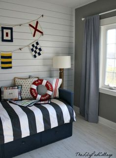 I painted this IKEA bed with navy chalk paint and put up MDF planking on the wall.