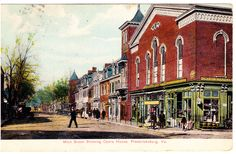 """Fredericksburg, VA - 1000 Block of Main Street, now Caroline Street.  The large building on the right was the former """"Opera House"""" and served for years as the local entertainment venue.  The story goes that this is where Benjamin T. Pitts got his start in his string of 30(+) """"moving pictures"""" theaters."""