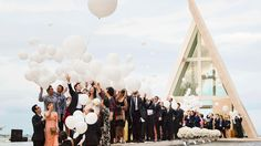 Releasing balloons as the bride and groom leave the chapel as the Mr. and Mrs. at Conrad Bali!